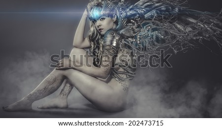 naked woman with iron and metal wings, art scene with gothic effects - stock photo