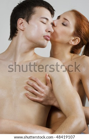 Naked young couple kissing and embracing