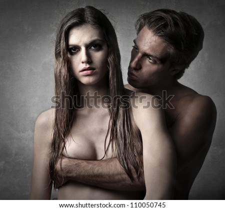 Naked young man hugging his girlfriend - stock photo