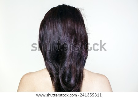 Naked young woman from the back. - stock photo