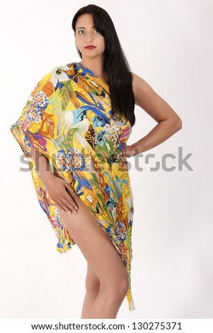 Naked young woman wrapped in a towel / The magic of the dawn - stock photo