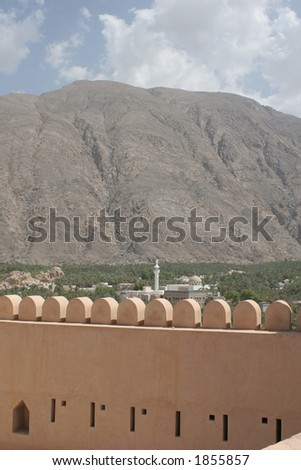 Nakhal Fort and Hajar Mountains - stock photo