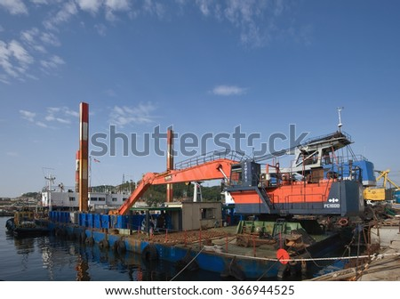 Nakhodka, Russia - September 20, 2015: The dredger Komatsu PC 1600 stands at the pier in the port of Nakhodka.