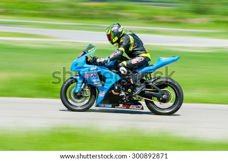NAKHON PATHOM - JULY 25 : Chanakorn K. with Suzuki GSX R1000 motorcycle in Thailand SuperBikes Championship 2015 Round 1 at Thailand Circuit, on July 25, 2015 in Nakhon Pathom, Thailand. - stock photo
