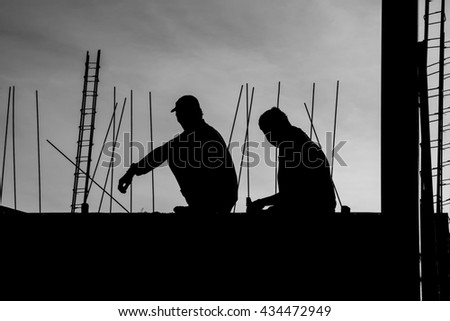 Nakhon Pathom, Kingdom of Thailand - June 2, 2016: Construction workers take a break time, relax and sit down on the beams of the building (Black and White)