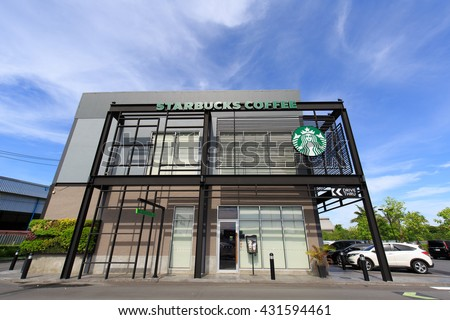 NAKHON PATHOM, THAILAND -?? JUNE 5, 2016: Starbucks  drive through shop beside road in local of Thailand. Starbucks is leader of premium coffee brand in Thailand, expand branches widely and rapidly.