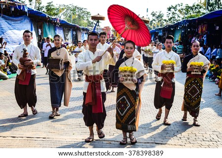NAKHON PHANOM,THAILAND-FEBRUARY15 :Unidentified Participants march in Thai traditional dress at Wat Phra Thatphanom festival of year ,Nakhon Phanom Thailand,February 15,2016