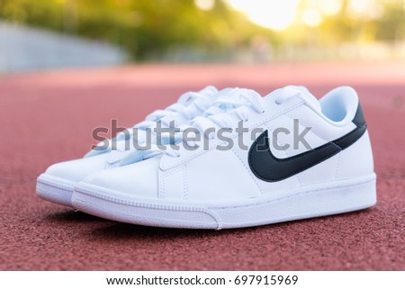 NAKHON PRATHOM, THAILAND - AUGUST 12, 2017:Nike tennis shoe, classic white/black ,Nike, Inc. is an American multinational corporation that designs, develops, manufactures and sells tennis shoes.