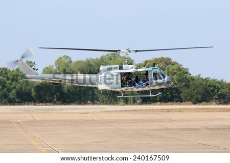 Nakhon Ratchasima - JAN 11: Helicopter show on children's Day at Korat Royal Thai Air Force Base located in northeast Thailand, January 11, 2014, Nakhon Ratchasima, Thailand. - stock photo