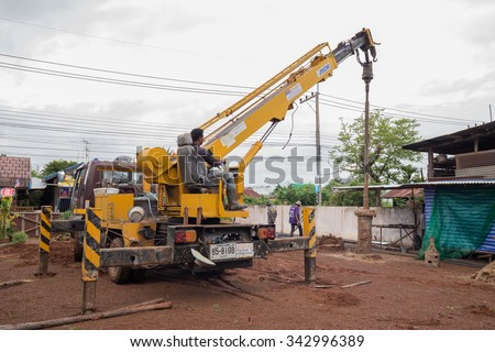 NAKHON RATCHASIMA - NOV 10 : unidentified technician with machine for drilling holes in the ground at construction site on November 10, 2015 at Nakhon Ratchasima, Thailand