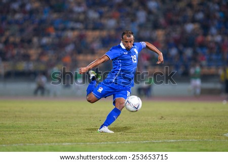 NAKHON RATCHASIMA THA-Feb07:Adul Lahso#19 of Thailand hit the ball during the 43rd King's cup match between Thailand and Korea Rep at Nakhon Ratchasima stadium on February07,2015 in Thailand. - stock photo