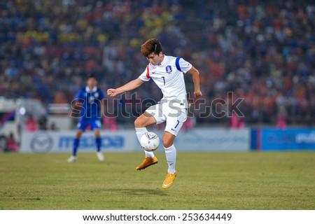 NAKHON RATCHASIMA THA-Feb07:Ahn Yong-woo of Korea controls the ball playing during the 43rd King's cup match between Thailand and Korea Rep at Nakhon Ratchasima stadium on February07,2015 in Thailand. - stock photo