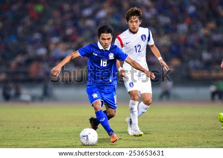 NAKHON RATCHASIMA THA-Feb07:Chanathip Songkrasin#18 of Thailand in action during the 43rd King's cup match between Thailand and Korea Rep at Nakhon Ratchasima stadium on February07,2015 in Thailand. - stock photo
