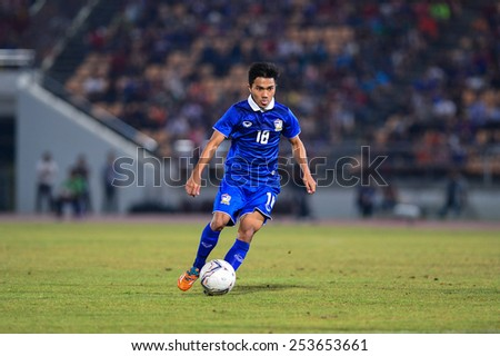 NAKHON RATCHASIMA THA-Feb7:Chanathip Songkrasin of Thailand run with a ball during the 43rd King's cup match between Thailand and Korea Rep at Nakhon Ratchasima stadium on February07,2015 in Thailand. - stock photo