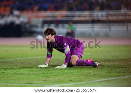 NAKHON RATCHASIMA THA-Feb07:Goalkeeper Kim Seung-gyu of Korea reacts during the 43rd King's cup match between Thailand and Korea Rep at Nakhon Ratchasima stadium on February07,2015 in Thailand. - stock photo