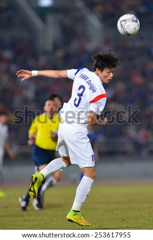 NAKHON RATCHASIMA THA-Feb07:Kim Jin-su #3 of Korea Rep in action during the 43rd King's cup match between Thailand and Korea Rep at Nakhon Ratchasima stadium on February07,2015 in Thailand. - stock photo