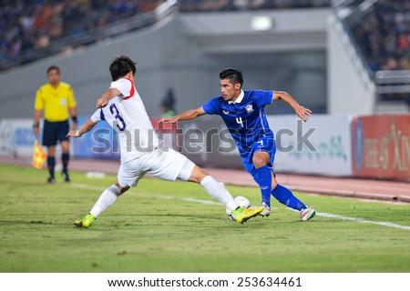 NAKHON RATCHASIMA THA-Feb07:Kroekrit Thaweekarn#4 of Thailand contols ball during the 43rd King's cup match between Thailand and Korea Rep at Nakhon Ratchasima stadium on February07,2015 in Thailand. - stock photo