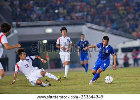 NAKHON RATCHASIMA THA-Feb07:Kroekrit Thaweekarn#4 of Thailand in action during the 43rd King's cup match between Thailand and Korea Rep at Nakhon Ratchasima stadium on February07,2015 in Thailand - stock photo