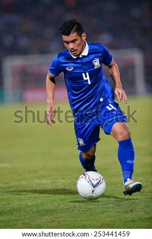 NAKHON RATCHASIMA THA-Feb07:Peerapat Notchaiya of Thai controls the ball during the 43rd King's cup match between Thailand and Korea Rep at Nakhon Ratchasima stadium on February07,2015 in Thailand. - stock photo