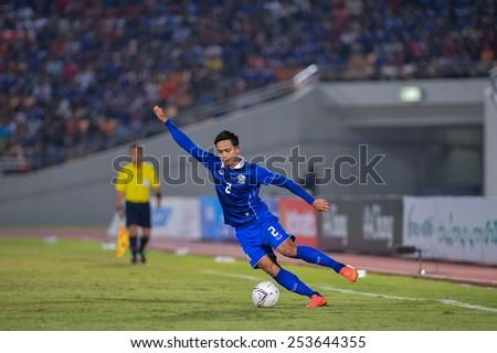 NAKHON RATCHASIMA THA-Feb07:Peerapat Notchaiya#2 of Thailand contols a ball during the 43rd King's cup match between Thailand and Korea Rep at Nakhon Ratchasima stadium on February07,2015 in Thailand - stock photo