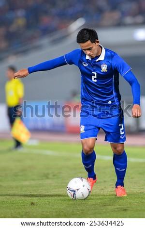 NAKHON RATCHASIMA THA-Feb07:Peerapat Notchaiya of Thailand kicks a ball during  the 43rd King's cup match between Thailand and Korea Rep at Nakhon Ratchasima stadium on February07,2015 in Thailand. - stock photo