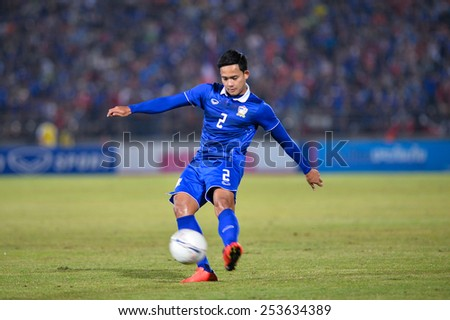 NAKHON RATCHASIMA THA-Feb07:Peerapat Notchaiya of Thailand kicks the ball during the 43rd King's cup match between Thailand and Korea Rep at Nakhon Ratchasima stadium on February07,2015 in Thailand. - stock photo
