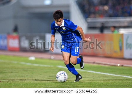 NAKHON RATCHASIMA THA-Feb07:Pinyo Inpinit#16 of Thailand contols the ball during the 43rd King's cup match between Thailand and Korea Rep at Nakhon Ratchasima stadium on February07,2015 in Thailand - stock photo