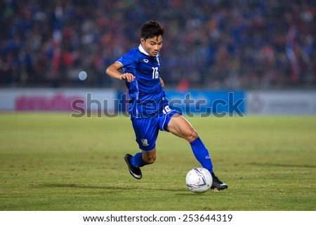 NAKHON RATCHASIMA THA-Feb07:Pinyo Inpinit#16 of Thailand controls the ball during the 43rd King's cup match between Thailand and Korea Rep at Nakhon Ratchasima stadium on February07,2015 in Thailand - stock photo