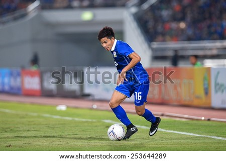 NAKHON RATCHASIMA THA-Feb07:Pinyo Inpinit#16 of Thailand in action during the 43rd King's cup match between Thailand and Korea Rep at Nakhon Ratchasima stadium on February07,2015 in Thailand - stock photo