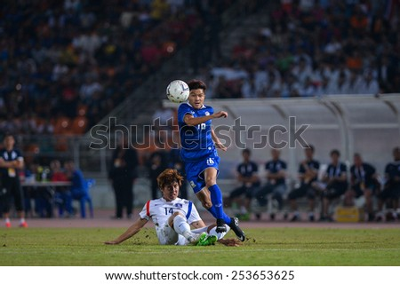 NAKHON RATCHASIMA THA-Feb07:Pinyo Inpinit#16 of Thailand in action during the 43rd King's cup match between Thailand and Korea Rep at Nakhon Ratchasima stadium on February07,2015 in Thailand. - stock photo