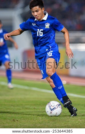 NAKHON RATCHASIMA THA-Feb07:Pinyo Inpinit#16 of Thailand kicks a ball during  the 43rd King's cup match between Thailand and Korea Rep at Nakhon Ratchasima stadium on February07,2015 in Thailand - stock photo