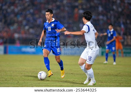 NAKHON RATCHASIMA THA-Feb07:Pokkhao Anan#10 of Thailand in action during the 43rd King's cup match between Thailand and Korea Rep at Nakhon Ratchasima stadium on February07,2015 in Thailand - stock photo