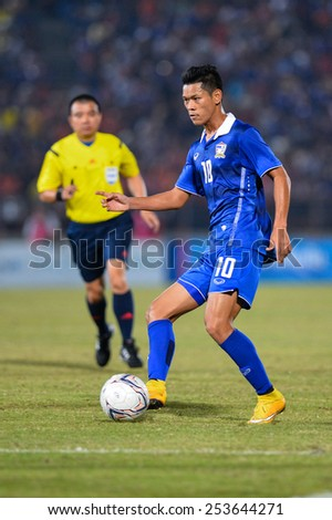 NAKHON RATCHASIMA THA-Feb07:Pokkhao Anan#10 of Thailand kicks a ball during the 43rd King's cup match between Thailand and Korea Rep at Nakhon Ratchasima stadium on February07,2015 in Thailand - stock photo
