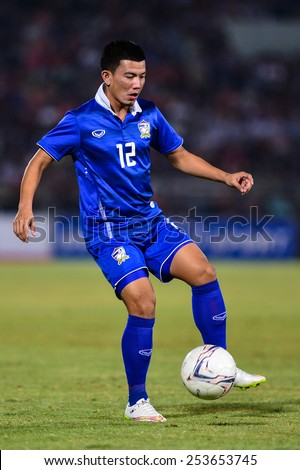 NAKHON RATCHASIMA THA-Feb07:Prakit Deeporm of Thailand contols the ball during the 43rd King's cup match between Thailand and Korea Rep at Nakhon Ratchasima stadium on February07,2015 in Thailand. - stock photo