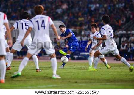 NAKHON RATCHASIMA THA-Feb07:Thitipan Puangchan#7 of Thailand hit the ball during the 43rd King's cup match between Thailand and Korea Rep at Nakhon Ratchasima stadium on February07,2015 in Thailand. - stock photo