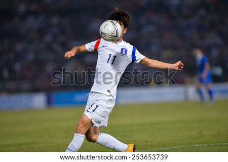 NAKHON RATCHASIMA THA-Feb07:Yun Il-lok of Korea Rep for the ball during the 43rd King's cup match between Thailand and Korea Rep at Nakhon Ratchasima stadium on February07,2015 in Thailand. - stock photo