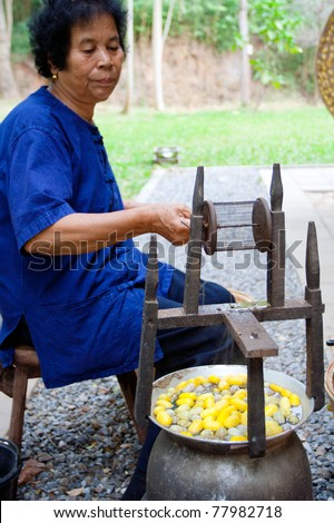 NAKHON-RATCHASIMA, THAILAND - DECEMBER 25: Traditional old style for pulling out silk thread from the cocoon by boiling them on December 25, 2008 in Nakhon-Ratchasima province, Thailand. - stock photo