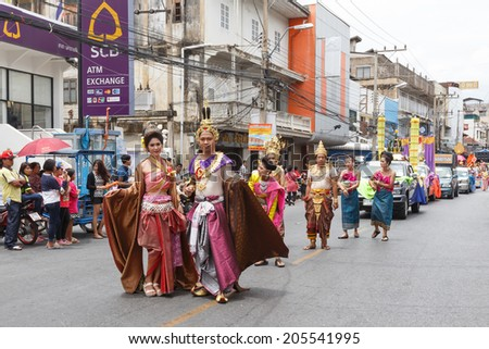 NAKHON RATCHASIMA, THAILAND - JULY 12: Thai people participate parade in grand of opening the traditional candle procession festival of Buddha, on July 12, 2014 in Nakhon Ratchasima, Thailand.