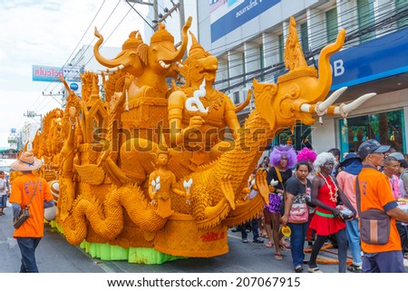 NAKHON RATCHASIMA, THAILAND - JULY 12 : The traditional candle procession festival of Buddha on July 12, 2014 in Nakhon Ratchasima, thailand.