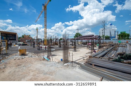 Nakhon Ratchasima, Thailand - June 9, 2015 : Unidentified workers work with reinforcement bars at a construction site. June 9, 2015 in Nakhon Ratchasima, Thailand