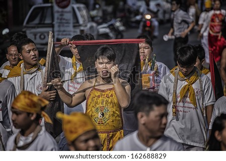 Nakhon Ratchasima, THAILAND - OCT 8: An unidentified devotee of Vegetarian Festival, person who invites the spirits of gods to possess their bodies on October 8, 2013 in Nakhon Ratchasima, Thailand - stock photo