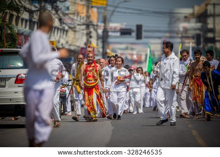 Nakhon Ratchasima, THAILAND - OCT 16: An unidentified devotee of Vegetarian Festival, person who invites the spirits of gods to possess their bodies on October 16, 2015 in Nakhon Ratchasima, Thailand
