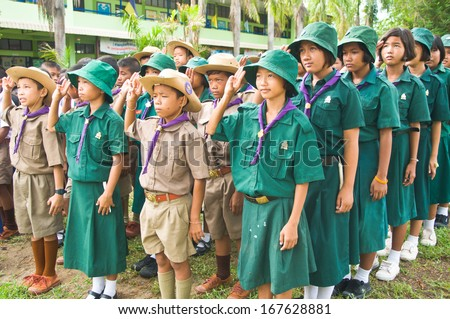 NAKHON SAWAN,THAILAND-JUNE 24: unidentified Thai Boy Scout and girl scout in Camp standing to respect the flag of nation. On June 24,2010 in Nakhon Sawan,Thailand.  - stock photo