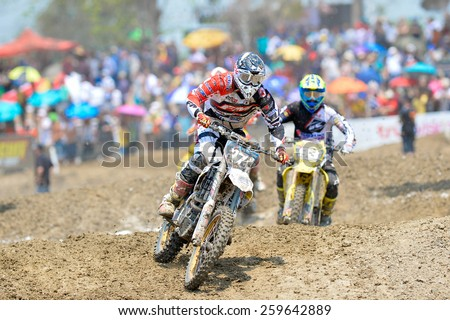 Nakhonchaisri,THAI-Mar8:Motocross riders perform on the competes during the Thai MX GP World Championship at thailand Circuit on March08,2015 in Nakhonpathom,Thailand.