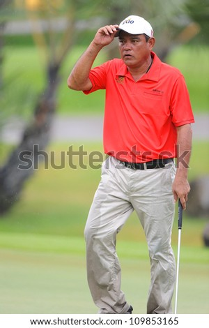 NAKHONPATHOM,THAILA ND-AUG 9:Boonchu Ruangkit of THA Waves to supporters after a putt during day one of the Golf Thailand Open at Suwan Golf&Country Club on August 9, 2012 in Nakhonpathom Thailand