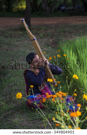 NAKHONRACHASIMA province, THAILAND - OCTOBER 31,2015. Thailand's northeastern Thailand. Play traditional folk music at field rice paddy. on October 31,2015 in Nakhon ratchasima, Thailand. - stock photo