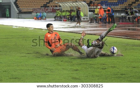 NAKHONRATCHASIMA THAILAND-AUG 2:Sathaporn Dof Nakhon Ratchasima FC in action during the Thai Premier League Suphanburi F.C.and Nakhon Ratchasima FCat 80th Birthday Stadium on Aug 2,2015 in Thailand. - stock photo