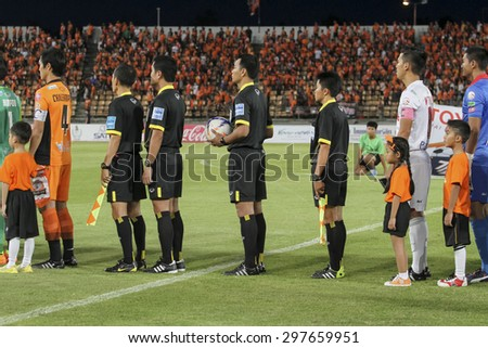 NAKHONRATCHASIMA THAILAND-JULY 18:football referee  in action during the Thai Premier League Bangkok Utd FC and Nakhon Ratchasima FCat 80th Birthday Stadium on July18,2015 in Thailand. - stock photo