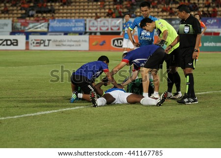 NAKHONRATCHASIMA THAILAND-JUN22: Doctors stand by for help injured player in action during ThaiLeague Army United F.C.and Nakhon Ratchasima FCat 80th Birthday Stadium on June22,2016 in Thailand.