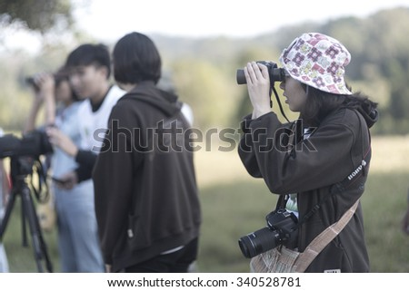 Nakhonratchasima, THAILAND - NOVEMBER 15 : Bird watchers and nature lovers Tourists enjoy watching the Bird on November 15, 2015 at Khao Yai National Park in Nakhonratchasima, Thailand